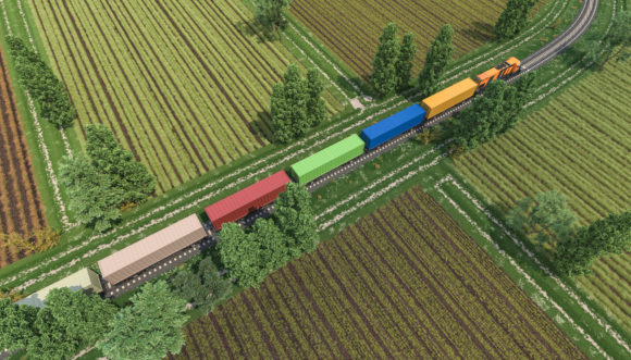 3d rendering image of a freight train in the middle of cultivated lands