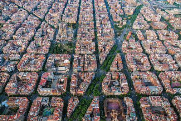 Aerial view of Barcelona Eixample residencial district with famous urban grid, Spain. Late afternoon light